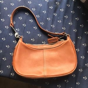 Small brown leather coach bag